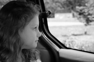 Anslie Looking Out Car Window B & W